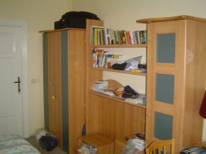 The wardrobe.  One view of my one room.